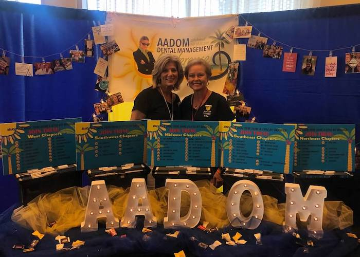 Two women in the AADOM Chapter Booth 2019