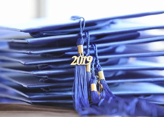 A blue graduation cap for AADOM