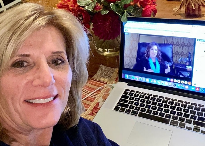 Taking a selfie during a zoom meeting